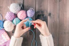 Woman's hand knitting scarf, handcraft. Stock Photos