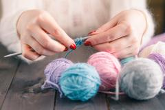 woman's hand knitting scarf, handcraft. - stock photo
