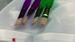 Several paintbrushes set down. Stock Footage