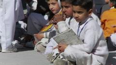 School boys waiting books Stock Footage