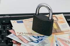 Secure payments online: padlock on a keyboard - stock photo