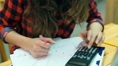 Student doing exercises on mathematics, steadycam shot - stock footage