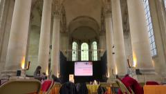 Buisness meeting, conference room in a big church, preparation - vertical pan - stock footage