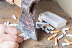 Anti-smoking background. Chopped cigarettes Stock Photos