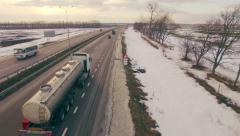Aerial view of truck moving on highway. Winter. - stock footage