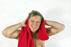 Man toweling hair after shower Stock Photos