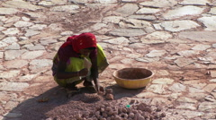 Woman breaking up dirt clods Stock Footage