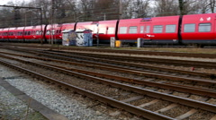 Two danish trains passing - electric regional train and train to Sweden Stock Footage
