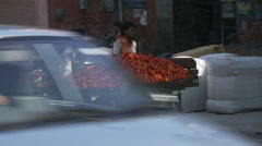 Two men pushing tomato cart Stock Footage