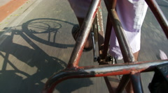 Shadow of  bicycle rickshaw, feet and pedals Stock Footage