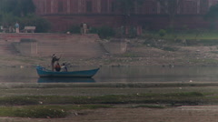 Three people in Boat on Yamuna river Stock Footage