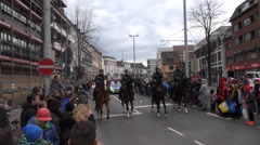 4k Schoduvel carnival horse riding police Brunswick Germany Stock Footage