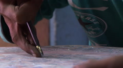 Up close view of person hand carving leather Stock Footage