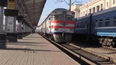 Diesel train leaves. Winter, Day, Railway Station Stock Footage
