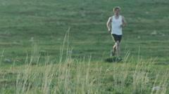 Man running through desert landscape Stock Footage