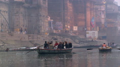 Tourists in rowboat - stock footage