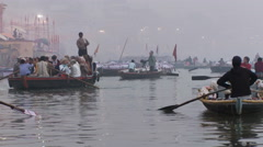 Many boats on the water rowing. City shoreline partially obscured by fog. - stock footage