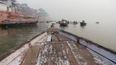 Boat bow and other boats rowing on foggy lake in India. - stock footage