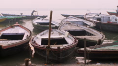 Wooden boats floating past docked boats Stock Footage