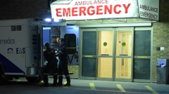 Ambulance at Hospital Unloading Patient Stock Footage