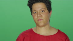 Woman with short hair looks serious, on a green screen background Stock Footage