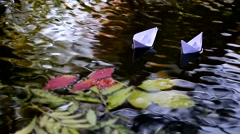 Two beautiful white paper boat floating on the river Stock Footage