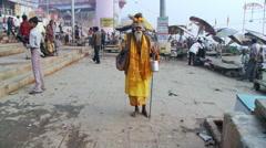 Holy man walks towards camera - stock footage