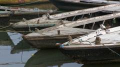 Medium tight shot of several moored boats. Stock Footage
