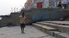 Indian boy pulling on a kite string. - stock footage