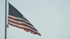 American Flag waving in sky Stock Footage