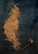 Brown buckwheat groats on dark grunge background - stock photo