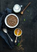 Rustic healthy breakfast set. Cooked buckwheat groats with milk and honey on  Stock Photos