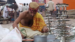 Closeup view of man preparing candles for Arti ceremony Stock Footage