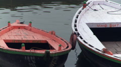 Two moored boats floating by each other. Stock Footage