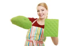 Smiling housewife in kitchen apron Stock Photos