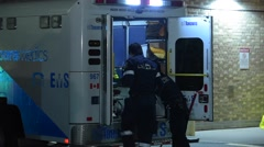 Paramedics Unloading Patient at Hospital - stock footage
