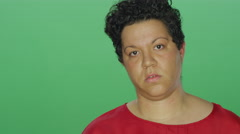 Woman with short hair looks stressed, on a green screen background Stock Footage