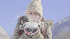Carefree Teen Blows Handful Of Snow At Camera, In Slow Motion Stock Footage