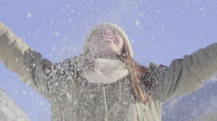 Carefree Teen Throws Snow In The Air And Lets It Fall Around Her Stock Footage
