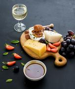 Cheese appetizer selection or whine snack set. Variety of cheese, grapes, pec - stock photo