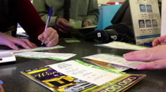 One side of lottery center with worker counting money inside shopping mall Stock Footage