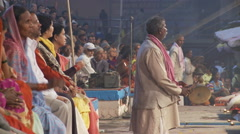 Several men playing small gongs for an incense offering to the Ganges river. Stock Footage
