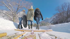 Gopro Footage (Perspective From Sled) Of Teens Walking On Snowy Road With Sleds Stock Footage