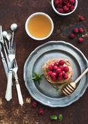 Breakfast set. Buckwheat pancakes with fresh raspberries, honey and mint leav - stock photo
