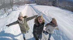 Teens Run Down Snowy Road With Gopro Stick, Filming Action Adventure Video Stock Footage