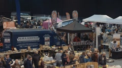 Stock Video Footage of Crowd of People Shopping at Camper Mart, Telford UK, Panning Shot