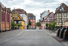 COLMAR, FRANCE - JUNE, 20: Colorful traditional french houses and empty road  - stock photo