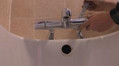 Plumber fixing bath shower mixer faucet Stock Footage