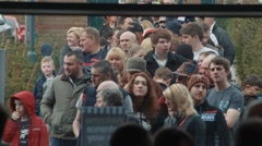 Line of People Waiting Outside Event Venue - stock footage