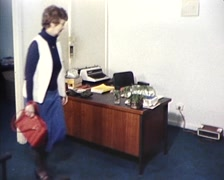 Stock Video Footage of 1980s Woman Arrives to Work at Office Deck